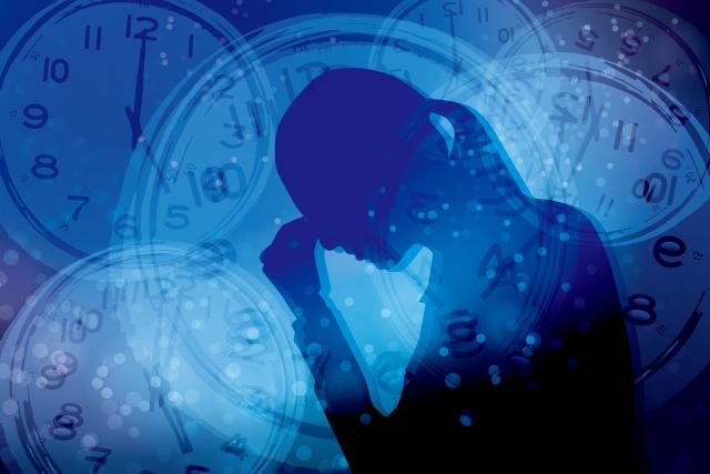 ストレスを抱える女性と時間